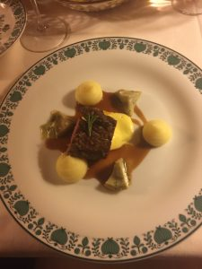 The veal filet in crunchy onions with artichoke, potatoes and sauce Hollandaise