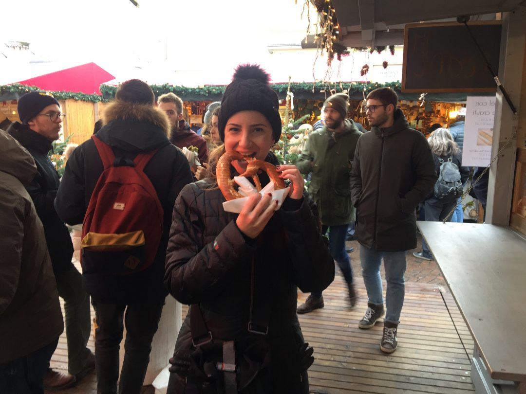 Eating Brezel at the Christmas market in Merano, Alto Adige